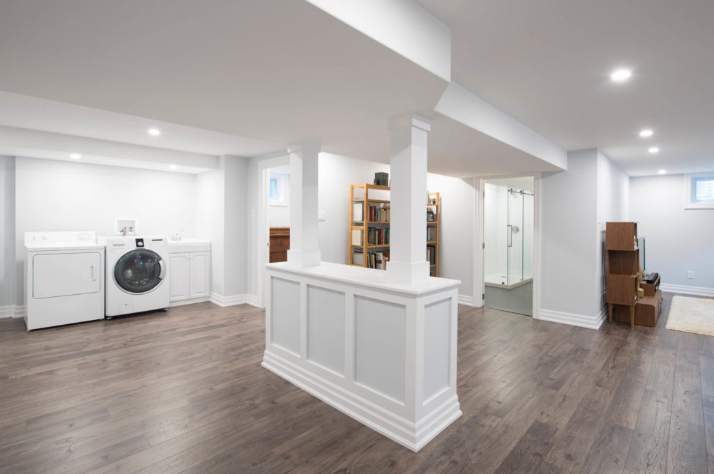 Renovated and finished basement with beautiful wood flooring.