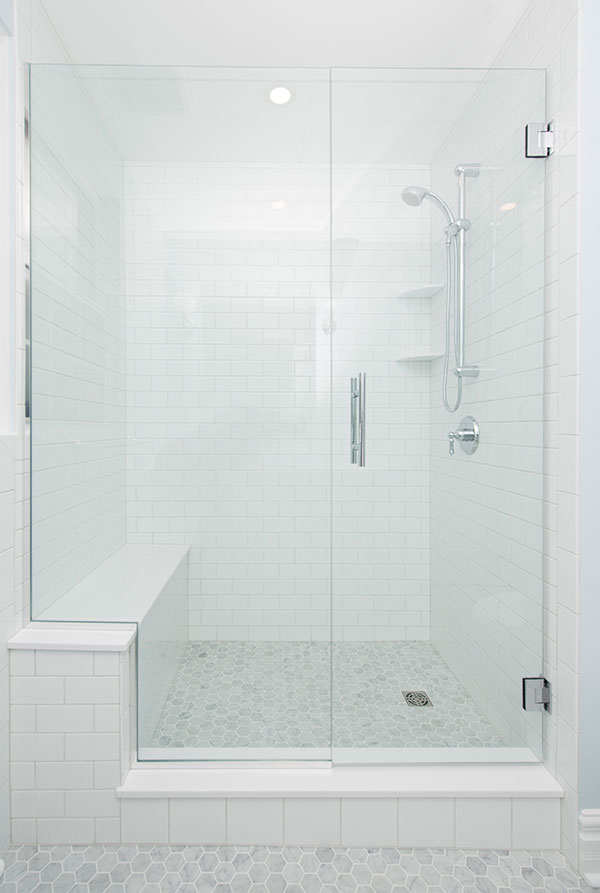 A shower with a bench for better accessibility.