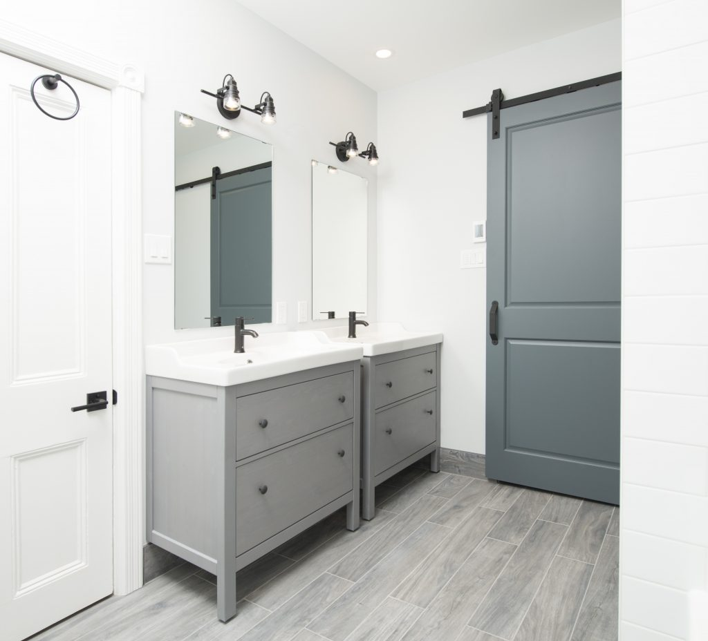 A pair of elegant bathroom vanities and a beautifully elegant sliding door, such as these, are fantastic ideas for bathroom renovations.