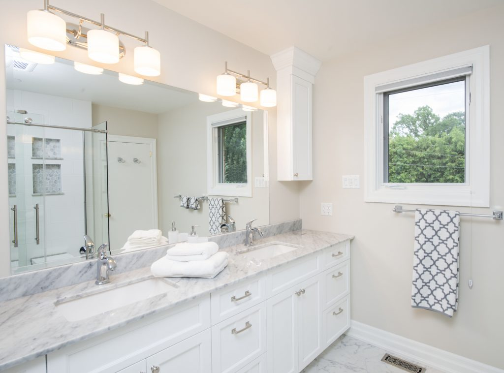A beautiful marble countertop perfectly complements this renovated bathroom.