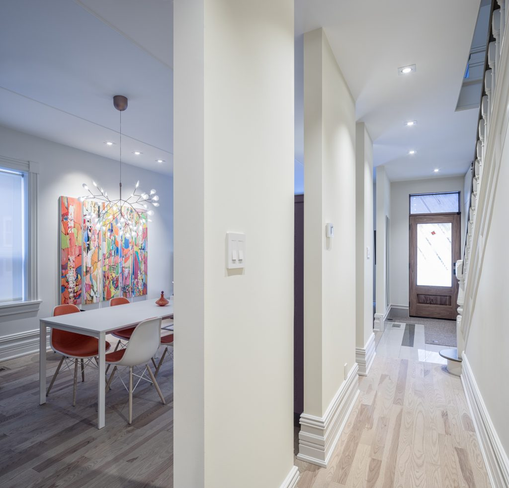 This hallway features stunning baseboards and hardwood floors.