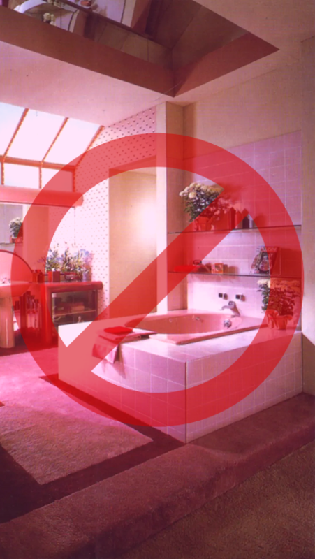 prohibited sign over a pink carpeted bathroom from the 70's era
