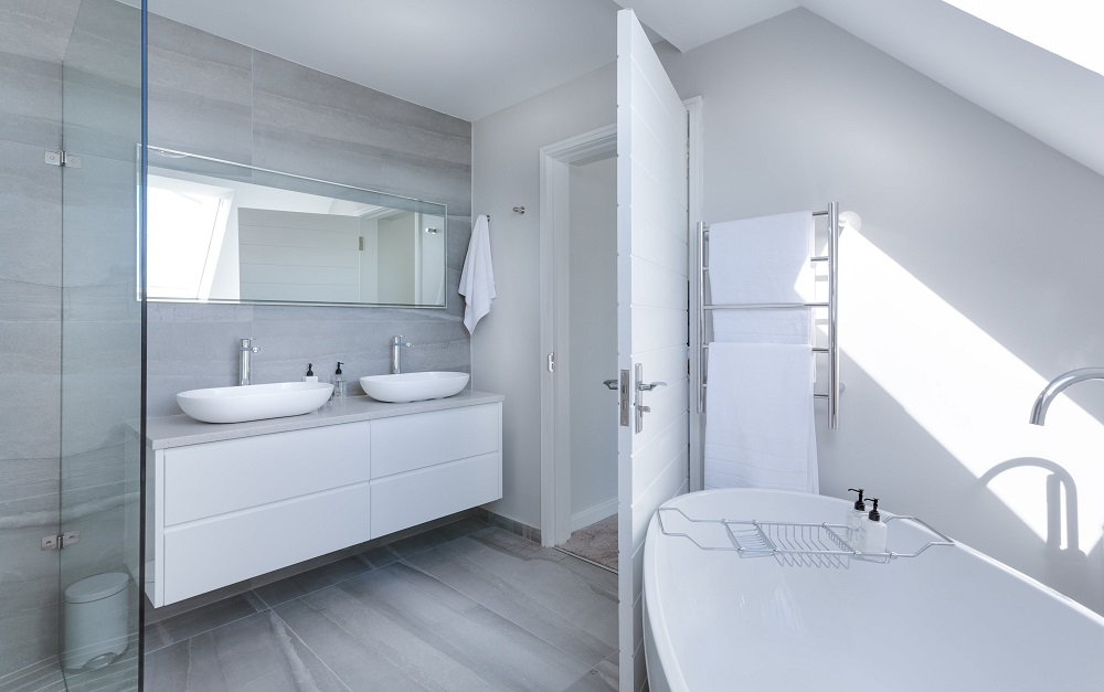 crisp, white bathroom with high-end building materials